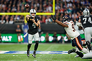 Derek Carr (QB) of the Oakland Raiders passes during the International Series match between Oakland Raiders and Chicago Bears at Tottenham Hotspur Stadium, London, United Kingdom on 6 October 2019.