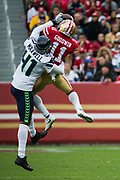San Francisco 49ers wide receiver Marquise Goodwin (11) catches a pass over Seattle Seahawks cornerback Byron Maxwell (41) at Levi's Stadium in Santa Clara, Calif., on November 26, 2017. (Stan Olszewski/Special to S.F. Examiner)