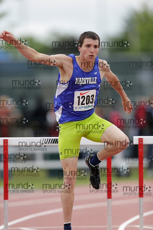Austin Mathieu of Markville SS - Markham competes in the intermediate hurdle heats at the 2013 OFSAA Track and Field Championship in Oshawa Ontario, Saturday,  June 8, 2013.<br /> Mundo Sport Images/ Geoff Robins
