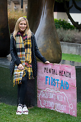 © Licensed to London News Pictures. 08/10/2018. London, UK. Rachel Riley poses during a photocall in Westminster before delivering the Mental Health First Aid England petition to Downing Street. The petition is calling for a change in the law, to give mental health equal importance to physical health in the workplace. Photo credit : Tom Nicholson/LNP