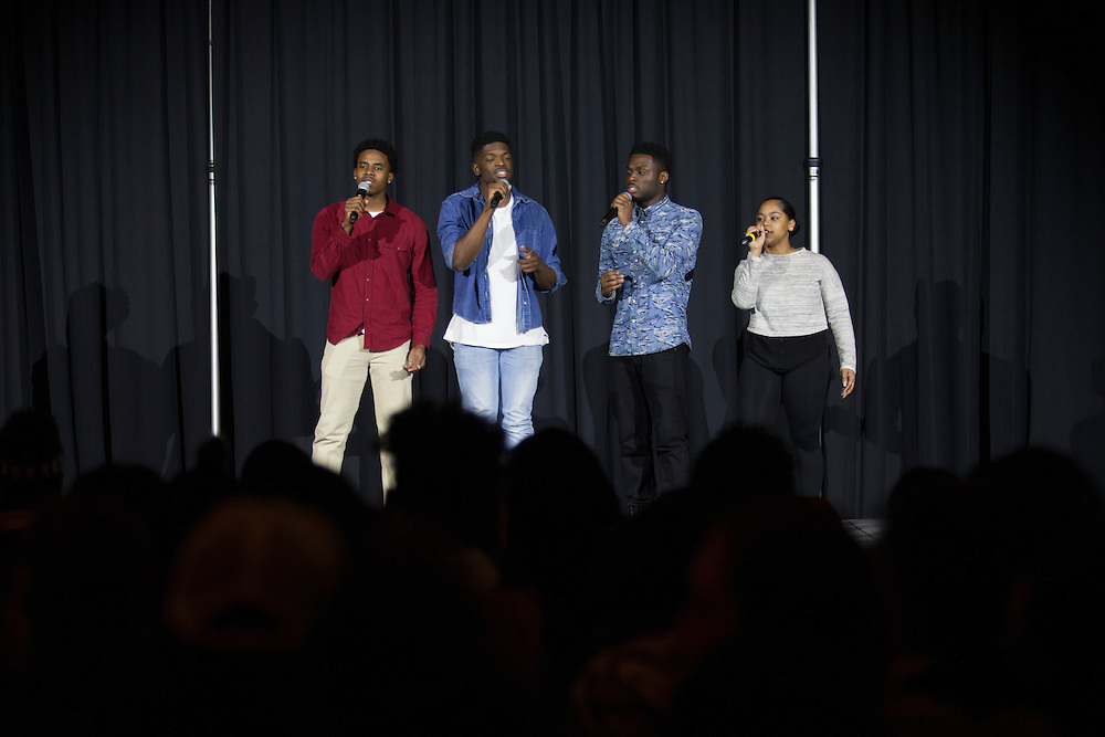 "(Left to right) Mulai Kamara, an electrical engineering student; De'Vaugn Williams, a communication studies and music production student' Jay Boamah, an undecided psychology student; and Jasmine, an undecided student; sing at the  Black Student Cultural Programming Board's talent showcase ""Apollo Night's Best"" on Friday, Feb. 5, 2016. The quartet won the talent showcase. Photo by Kaitlin Owens"