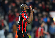 AFC Bournemouth forward Benik Afobe points to the sky after scoring his first goal for Bournemouth during the Barclays Premier League match between Bournemouth and Norwich City at the Goldsands Stadium, Bournemouth, England on 16 January 2016. Photo by Graham Hunt.