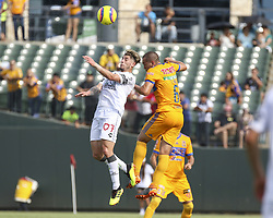 July 8, 2018 - Round Rock, USA - Pachuca midfielder Angelo Sagal (7) and Tigres defender Jorge Torres (6) leap to head the ball during a Liga MX friendly match between Tigres and Pachuca at Dell Diamond in Round Rock, Texas, on July 8, 2018. (Credit Image: © Scott W. Coleman via ZUMA Wire)