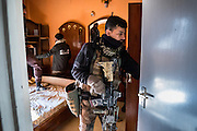 Members of the Iraqi Special Operations Force, Golden Division ISOF 2, Mosul Battalion clear a house in the Khadra housing complex which was suspected of harboring ISIS fighters and IEDs. Mosul, Iraq. Nov. 26, 2016. (Photo by Gabriel Romero ©2016)
