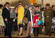 Attendants to at the Goodwood Revival dressed in vintage outfits take part in the best dressed contest in Chichester, England   Friday, Sept. 9, 2016 The historic motor racing festival celebrates the mid-20th-century golden era of the racing circuit and recreates the atmosphere from the 1950s and 1960s.(Elizabeth Dalziel)