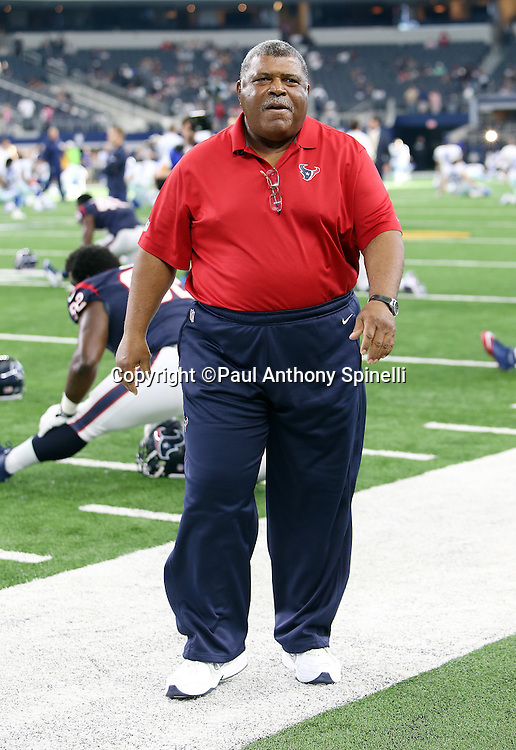 Houston Texans defensive coordinator Romeo Crennel paces the sideline before the 2015 NFL preseason football game against the Dallas Cowboys on Thursday, Sept. 3, 2015 in Arlington, Texas. The Cowboys won the game 21-14. (©Paul Anthony Spinelli)