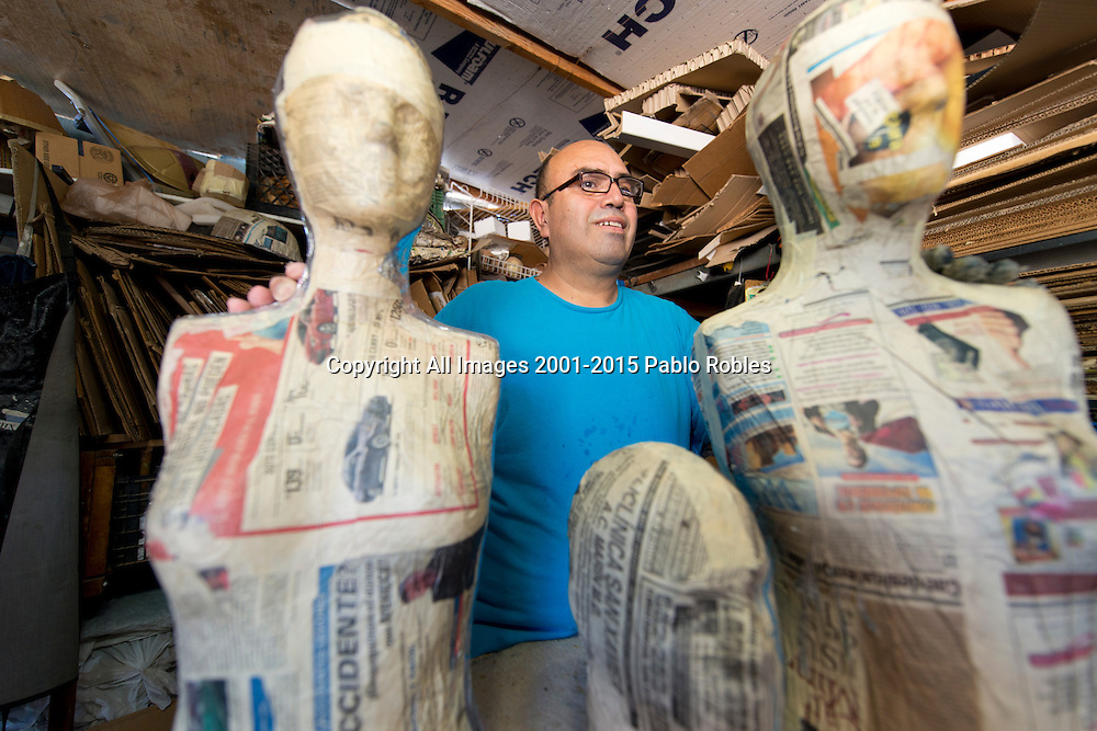 Jose Chavaria poses for a portrait in his Piñata shop in Phoenix, AZ.