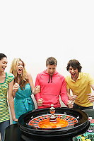 Group of friends winning on roulette wheel