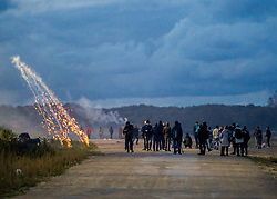 October 22, 2016 - London, Northern France, France - Image ©Licensed to i-Images Picture Agency. 22/10/2016. Calais Jungle, France. Rioting in the Calais Jungle. Rioters throw rocks at CRS riot police parked on an embankment next to the migrant camp and the police respond with teargas. Picture by Pete Maclaine / i-Images (Credit Image: © Pete Maclaine/i-Images via ZUMA Wire)