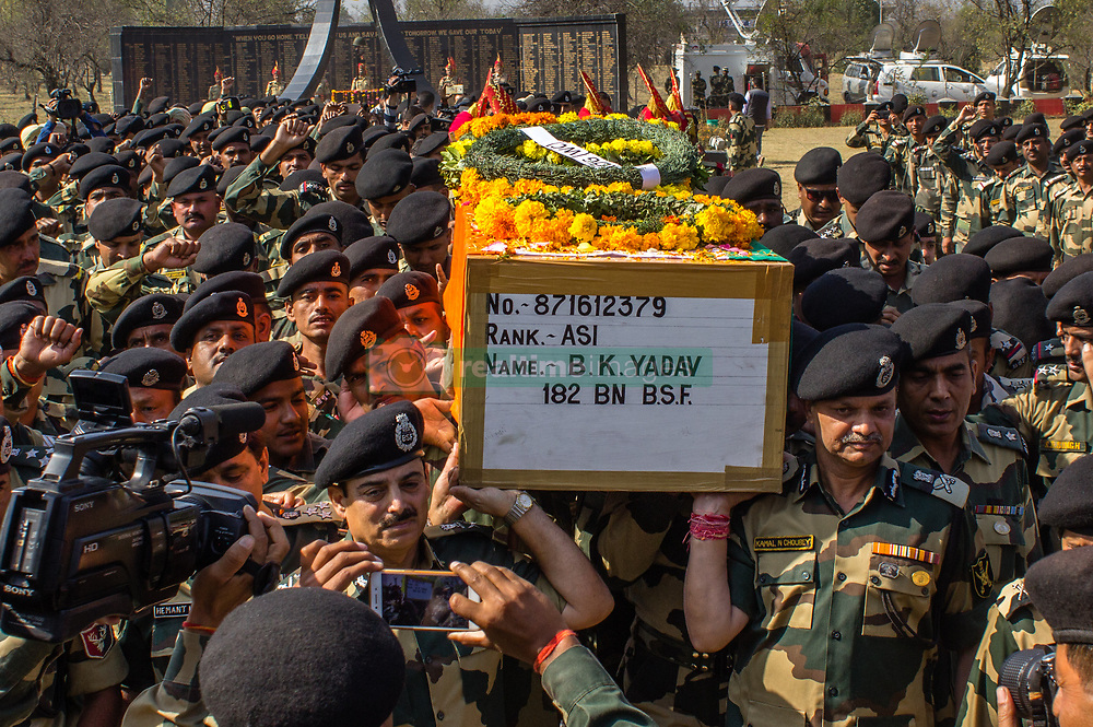 October 3, 2017 - Srinagar, Jammu and Kashmir, India - Indian Border Security Force (BSF) soldiers lay wreaths on the coffin containing the body of their officer killed in a gun battle with suspected militants at an Indian Border Security Force (BSF) camp on Tuesday, during a wreath laying ceremony , on October 04, 2017 in Srinagar, the summer capital of Indian administered Kashmir, India. A wreath laying ceremony was held today for an Indian Indian Border Security Force (BSF)  officer who was killed on Tuesday  in a gun battle after suspected militants attacked their camp in Srinagar outskirts  three militants were also killed in the battle. (Credit Image: © Yawar Nazir via ZUMA Wire)