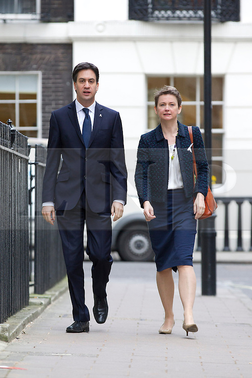 © Licensed to London News Pictures. 25/11/2013. London, UK. Labour Leader Ed Milliband and the Shadow Home Secretary Yvette Cooper are seen walking to the presentation of a report, carried out by the Independent Commission on the future of Policing in England and Wales, at the Royal Society of Arts in London today (25/11/2013). Photo credit: Matt Cetti-Roberts/LNP