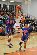 Newton North junior Thomas Andrae drives to the basket during the game against Newton South at Newton North, Dec. 27, 2018.   [Wicked Local Photo/James Jesson]