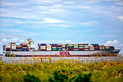 Container ship OOCL Europe sails outbound at the mouth of the Savannah River from the Georgia Ports Authority Port of Savannah, Tuesday, July, 18, 2017, in Tybee Island, Ga. (GPA Photo/Stephen B. Morton)