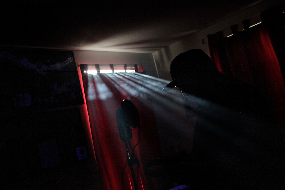 """Black lights producing harps from heaven."" Light filters in from outside revealing the silhouette of Robert Pigozzi, a.k.a. ""Wizeass,"" as he records a mixed tape in a marijuana haze at the home of Ernie Bordon, a.k.a. ""EbGb,"" in East Naples."
