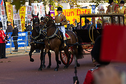 London, October 20th 2015. Following a Ceremonial welcoming to the UK by the Queen and The Duke of Edinburgh at Horse Guards Parade, a procession of carriages travels down the Mall past thousands of Chinese expatriates and Tibetan protesters. PICTURED:The procesion passes Tibetan and  Falun Dafa protesters.
