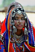 Young girl in national costume and jewels, Devara Yamzal, India.