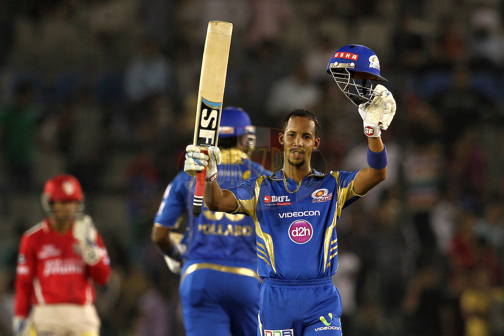 Lendl Simmons of the Mumbai Indians celebrate his century during match 48 of the Pepsi Indian Premier League Season 2014 between the Kings XI Punjab and the Mumbai Indians held at the Punjab Cricket Association Stadium, Mohali, India on the 21st May  2014<br /> <br /> Photo by Deepak Malik / IPL / SPORTZPICS<br /> <br /> <br /> <br /> Image use subject to terms and conditions which can be found here:  http://sportzpics.photoshelter.com/gallery/Pepsi-IPL-Image-terms-and-conditions/G00004VW1IVJ.gB0/C0000TScjhBM6ikg
