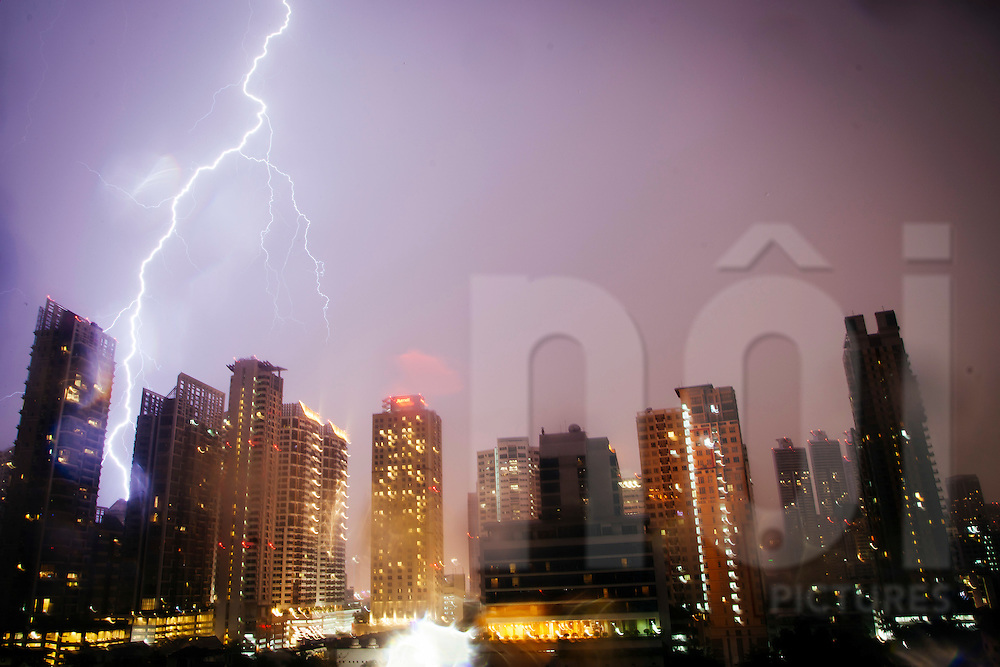 Lightning strikes a building at night, Bangkok, Thailand, Southeast Asia