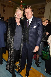 THEO & LOUISE FENNELL at a party to celebrate the publication of The Romanovs 1613-1918 by Simon Sebag-Montefiore held at The Mandarin Oriental, 66 Knightsbridge, London on 2nd February 2016.