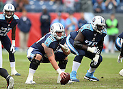 Tennessee Titans center Andy Gallik (69) gets set to snap the ball at the line of scrimmage with Tennessee Titans offensive tackle Byron Bell (76) getting set nearby during the 2015 week 7 regular season NFL football game against the Atlanta Falcons on Sunday, Oct. 25, 2015 in Nashville, Tenn. The Falcons won the game 10-7. (©Paul Anthony Spinelli)