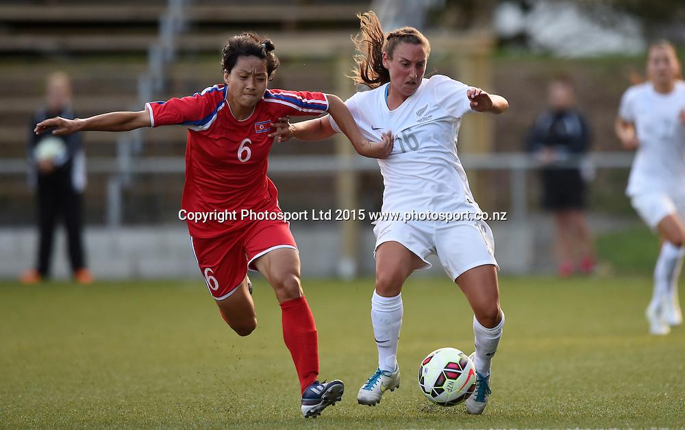 New Zealand's Annalie Longo on the attack with Korea's Ra Un Sim. Womens Football. New Zealand Football Ferns v Korea DPR. Auckland, New Zealand. Sunday 8 February 2015. Copyright Photo: Andrew Cornaga / www. Photosport.co.nz