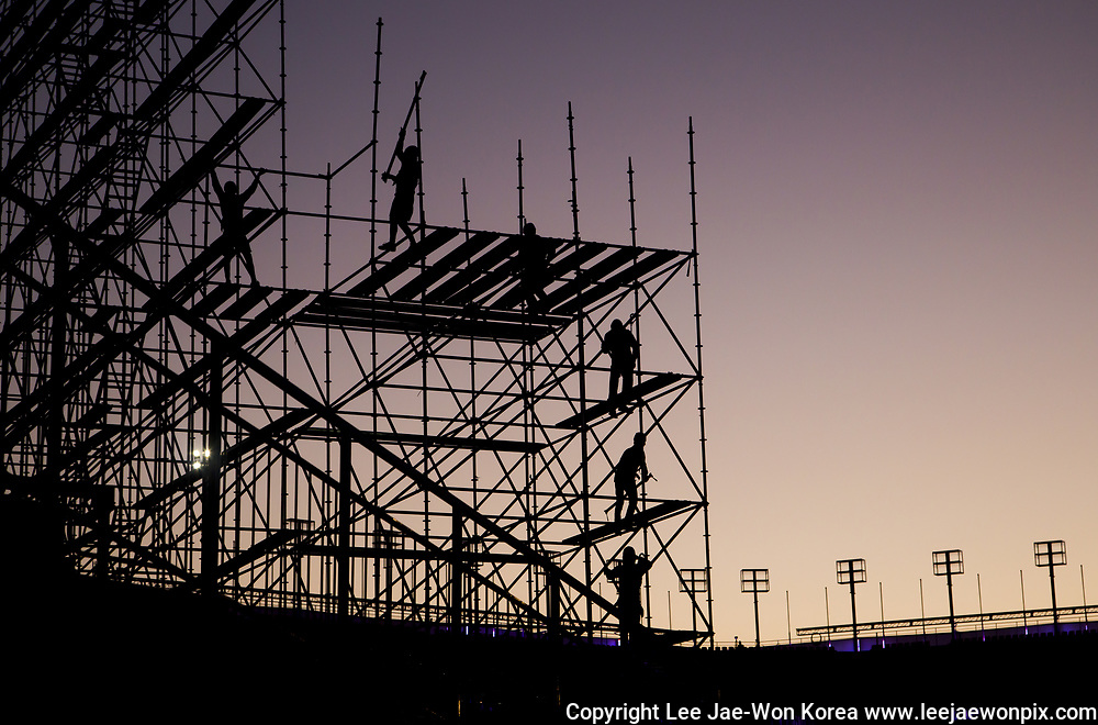 PyeongChang Olympic Stadium, Oct 30, 2017 : Workers working at PyeongChang Olympic Stadium are silhouetted during the sunset in PyeongChang, east of Seoul, South Korea. The 2018 PyeongChang Winter Olympics will be held for 17 days from February 9 - 25, 2018. The opening and closing ceremonies and most snow sports will take place in PyeongChang county. Jeongseon county will host Alpine speed events and ice sports will be held in the coast city of Gangneung. Photo by Lee Jae-Won (SOUTH KOREA) www.leejaewonpix.com