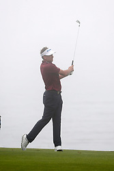 June 12, 2019 - Pebble Beach, CA, U.S. - PEBBLE BEACH, CA - JUNE 12: PGA golfer Ian Poulter plays the 18th hole in the fog during a practice round for the 2019 US Open on June 12, 2019, at Pebble Beach Golf Links in Pebble Beach, CA. (Photo by Brian Spurlock/Icon Sportswire) (Credit Image: © Brian Spurlock/Icon SMI via ZUMA Press)