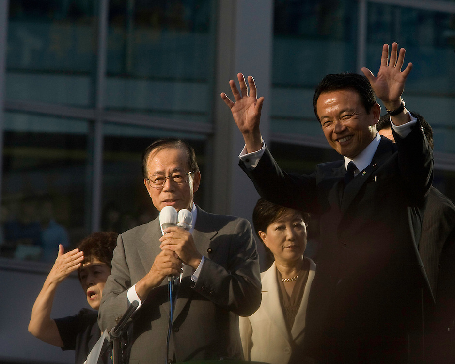 current PM Taro Aso,waves  to crowd in central Tokyo, during the campaign for the  election to fill the  position of Japanese Prime Minister the resignation Yasuo Fukuda  speaking won the  party election but resignes a year after taking office he was replaced by  Aso.