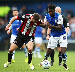 Lucas Joao of Sheffield Wednesday takes on Chris Basham of Sheffield United - Mandatory by-line:  Matt McNulty/JMP - 24/09/2017 - FOOTBALL - Hillsborough - Sheffield, England - Sheffield Wednesday v Sheffield United - Sky Bet Championship