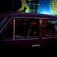 Anti-Mubarak protests in Alexandria. AFRICA, EGYPT, ALEXANDRIA,28.01.2011: after an afternoon of street clashes between antigovernment protesters and police the situation turns calmer in the evening. Four chidren are waiting for their parents in a Lada car.