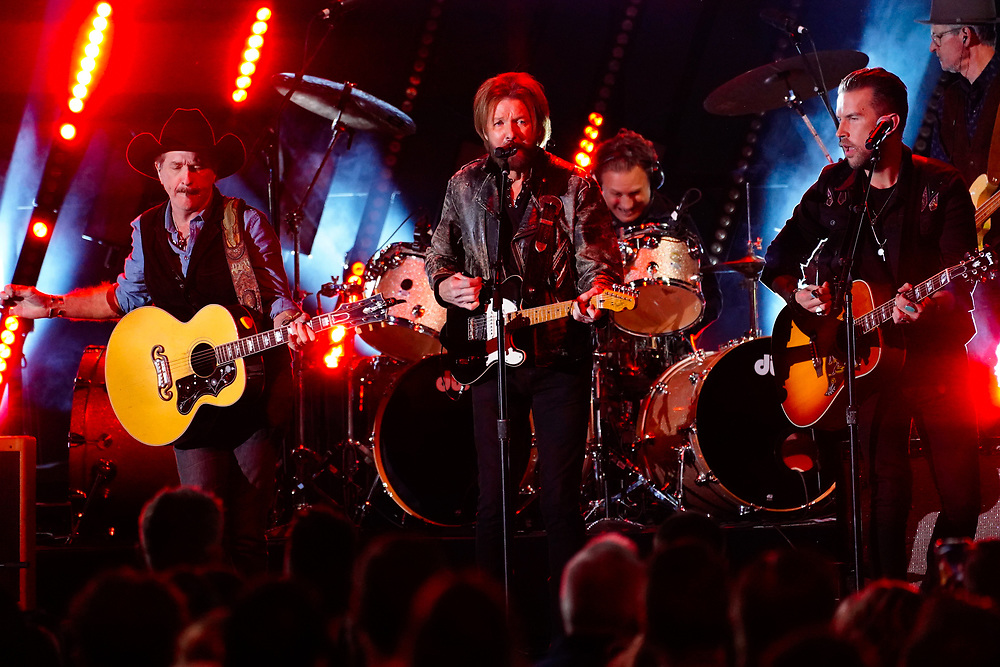 NASHVILLE, TENNESSEE - NOVEMBER 13:  Kix Brooks and Ronnie Dunn of Brooks & Dunn and T.J. Osborne of Brothers Osborne perform onstage during the 53rd annual CMA Awards at the Bridgestone Arena on November 13, 2019 in Nashville, Tennessee