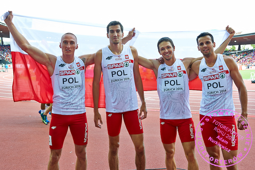 (L-R) Jakub Krzewina and Rafal Omelko and  Kacper Kozlowski and Lukasz Krawczuk all from Poland pose with Polish flag after won bronze medals in Men's Relay 4 x 400 meters final during the Sixth Day of the European Athletics Championships Zurich 2014 at Letzigrund Stadium in Zurich, Switzerland.<br /> <br /> Switzerland, Zurich, August 17, 2014<br /> <br /> Picture also available in RAW (NEF) or TIFF format on special request.<br /> <br /> For editorial use only. Any commercial or promotional use requires permission.<br /> <br /> Photo by &copy; Adam Nurkiewicz / Mediasport