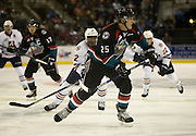 KELOWNA, CANADA - SEPTEMBER 24: Rodney Southam #17 of the Kelowna Rockets, Cal Foote #25 of the Kelowna Rockets, Scott Mahovlich #12 of the Kamloops Blazers, Quinn Benjafield #22 of the Kamloops Blazers chase after the puck at the Kelowna Rockets game on September 24, 2016 at Prospera Place in Kelowna, British Columbia, Canada.  (Photo By Cindy Rogers/Nyasa Photography,  *** Local Caption ***