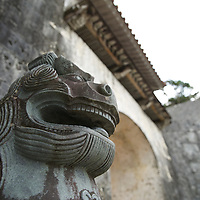 A Shisa lion guards the entry into Shuri-jo