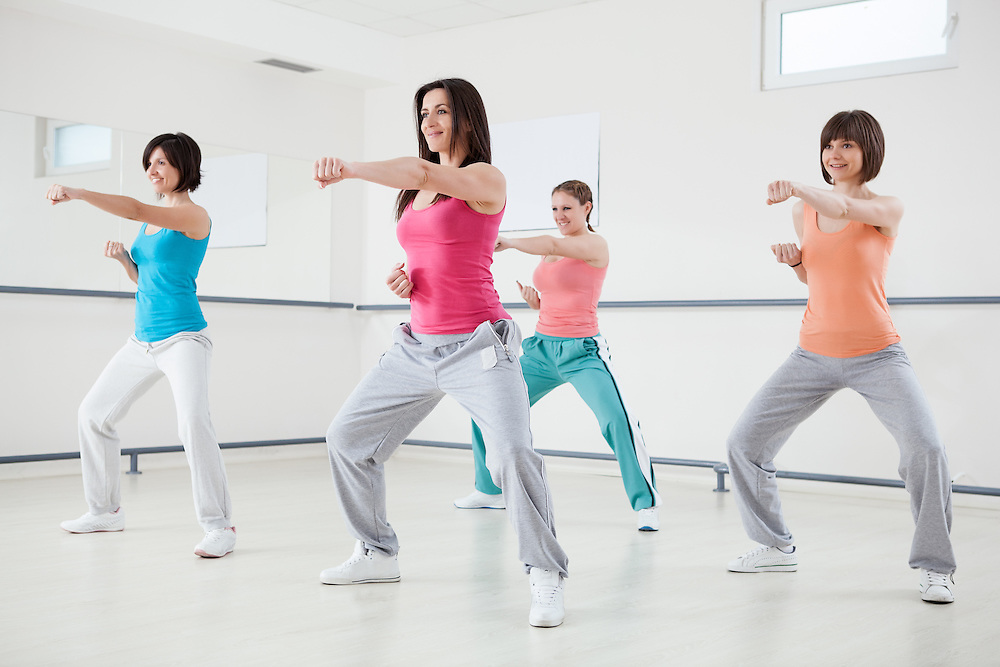 Group of smiling women in a fitness training.