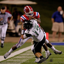 Sep 30, 2009; Ruston, LA, USA; Louisiana Tech Bulldogs linebacker Adrien Cole (44) hits Hawaii Warriors quarterback Greg Alexander (12) knocking him out for the remainder of the game with a leg injury during the second half at Joe Aillet Stadium. Louisiana Tech defeated Hawaii 27-6. Mandatory Credit: Derick E. Hingle-US PRESSWIRE