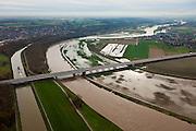 Nederland, Limburg, gemeente Stein, 15-11-2010; A76 over de Maas, rechts Belgie. De Maas (Grensmaas) treedt bij hoogwater buiten zijn oevers en het water wordt ook via de uiterwaarden stroomafwaarts afgevoerd. .A76 across the river, to Belgium. Maas (Meuse) overflowing its banks, the water is also discharged downstream via the floodplains.luchtfoto (toeslag), aerial photo (additional fee required).foto/photo Siebe Swart