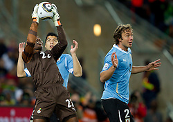 Goalkeeper of Ghana Richard Kingson vs Luis Suarez of Uruguay  and Diego Lugano of Uruguay during to the 2010 FIFA World Cup South Africa Quarter Finals football match between Uruguay and Ghana on July 02, 2010 at Soccer City Stadium in Sowetto, suburb of Johannesburg. (Photo by Vid Ponikvar / Sportida)