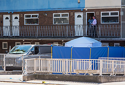 © Licensed to London News Pictures.  25/06/2018; Bristol, UK. Police conduct investigations and talk to local residents as a murder investigation has been launched after a man dies and two are seriously injured in an armed burglary in Prewett Street, Redcliffe, in the early hours of the morning. It is reported that neighbours have told of hearing bloodcurdling screams of as three men were attacked with a sword-like knife. Two other men who suffered life-threatening injuries have been taken to hospital. It is reported that two men from London have been arrested in connection with the incident. Photo credit: Simon Chapman/LNP