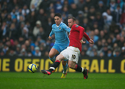 MANCHESTER, ENGLAND - Sunday, January 8, 2012: Manchester City's Samir Nasri in action against Manchester United's Wayne Rooney during the FA Cup 3rd Round match at the City of Manchester Stadium. (Pic by David Rawcliffe/Propaganda)