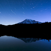 4:20 to 4:45 AM Star trails over Reflection Lakes. The small lights on the mountain are lamps of climbers attempting to summit at dawn. They began their hikes before midnight.