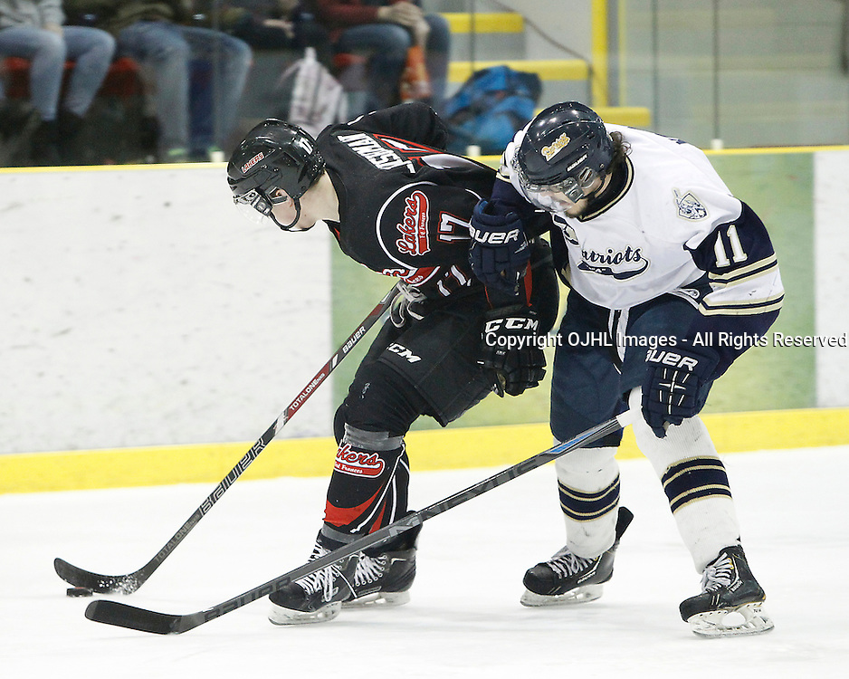 WELLINGTON, ON - Apr 29 : Dudley Hewitt Cup, Central Canadian Jr &quot;A&quot; Championship. Toronto Lakeshore Patriots vs Fort Francis Lakers. Hunter Leishman #17 of the Fort Francis Lakers and Niko Kovachis #11 of the Toronto Lakeshore Patriots battle for the puck during first period game action.<br /> (Photo by Tim Bates / OJHL Images)