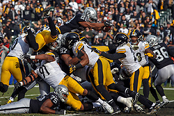 OAKLAND, CA - DECEMBER 09: Running back Doug Martin #28 of the Oakland Raiders dives for and scores a touchdown against the Pittsburgh Steelers during the first quarter at O.co Coliseum on December 9, 2018 in Oakland, California. (Photo by Jason O. Watson/Getty Images) *** Local Caption *** Doug Martin