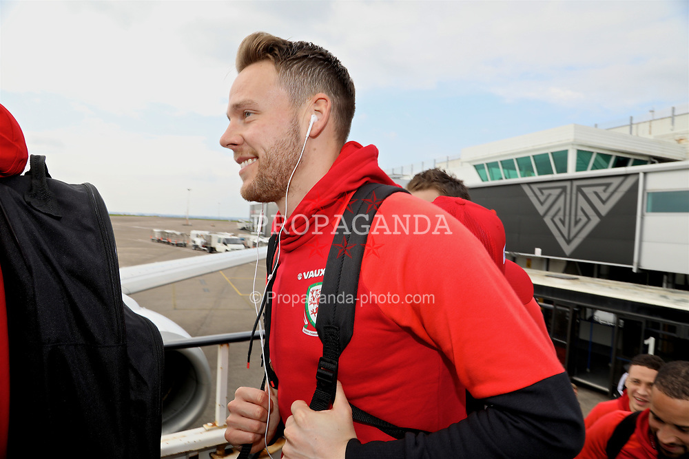 CARDIFF, WALES - Thursday, March 23, 2017: Wales' Chris Gunter boards the team plane as the squad depart Cardiff Airport to fly to Dublin ahead of the 2018 FIFA World Cup Qualifying Group D match against Republic of Ireland. (Pic by David Rawcliffe/Propaganda)