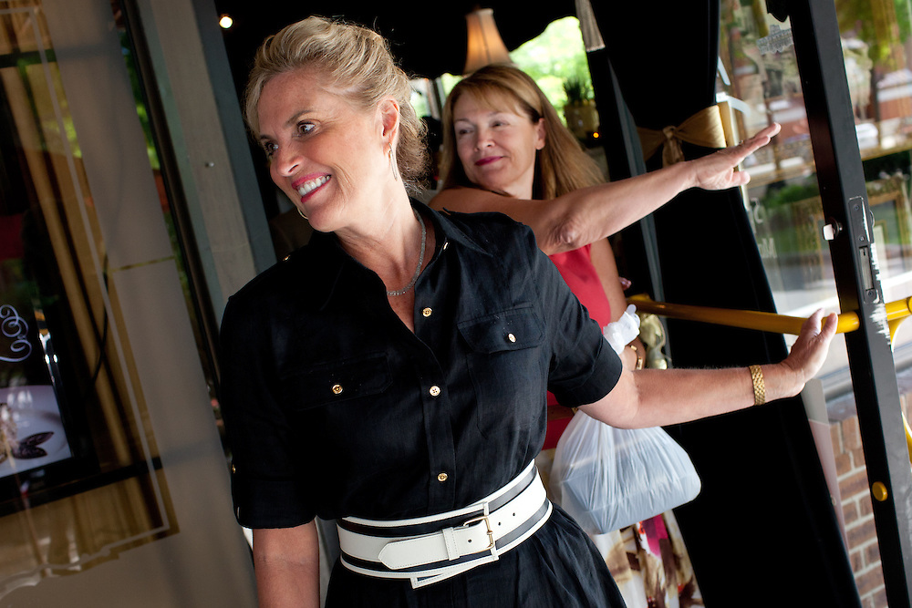 Political aide Susan Duprey (R) follows Ann Romney, the wife of Mitt Romney, out the door after at a campaign event at  Michele's Ristorante in Keene, NH on August 11, 2011.  (Matthew Cavanaugh for The Boston Globe)