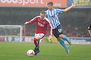 Swindon Town defender James Brophy and Coventry City defender Aaron Phillips during the Sky Bet League 1 match between Swindon Town and Coventry City at the County Ground, Swindon, England on 24 October 2015. Photo by Jemma Phillips.
