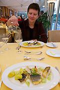 Parkhotel Tristacher See, Tyrol, Austria. Dinner at the restaurant.<br /> Variation von Edelfischen mit Pernod-Gurken und Dillkartoffeln.