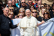 Pope Francis poses with members of an Argentine choir at the end of his weekly general audience at St Peter's square on May 16, 2018 in Vatican.
