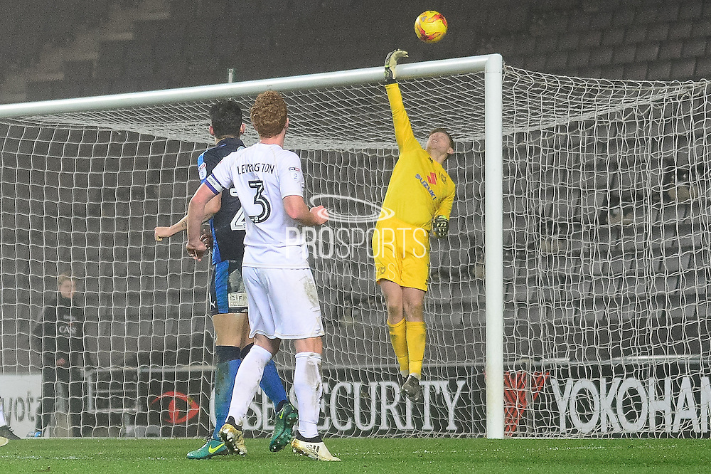 Milton Keynes Dons goalkeeper David Martin (1) makes an important save during the EFL Sky Bet League 1 match between Milton Keynes Dons and Swindon Town at stadium:mk, Milton Keynes, England on 30 December 2016. Photo by Dennis Goodwin.