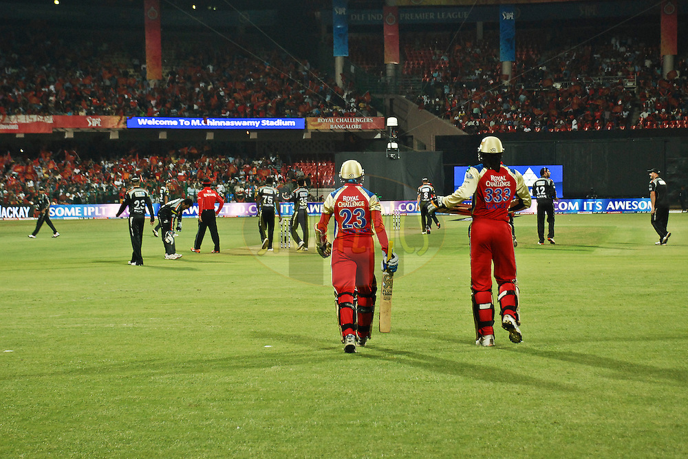 RCB batsman and PW fielders are going to the ground to start the match during match 35 of the the Indian Premier League ( IPL ) Season 4 between the Royal Challengers Bangalore and the Pune Warriors held at the Chinnaswamy Stadium, Bangalore, Karnataka, India on the 29th April 2011..Photo by Saikat Das/BCCI/SPORTZPICS